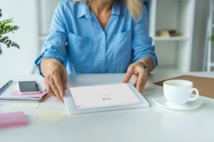 cropped view of businesswoman using digital tablet with Google website